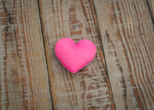 Pink Heart pillow on wood background . Stock Photography