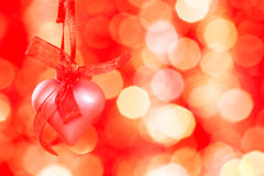 Pink heart on a red background. And bokeh royalty free stock images