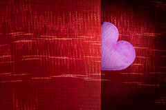 Pink heart with red fabric background blank space for a Valentin Royalty Free Stock Image