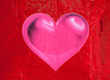 Pink heart on a red fence Royalty Free Stock Photo