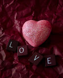 Pink heart on red with love tiles Royalty Free Stock Image