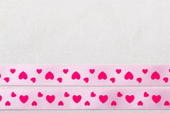 Pink heart ribbon on cloth background Stock Photo