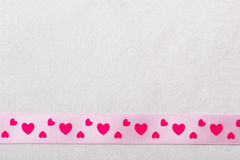 Pink heart ribbon on cloth background Royalty Free Stock Image