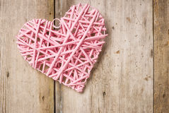 Pink heart on a rustic  background Stock Photo