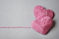 Pink heart shape. Made from wool on grey background Stock Images