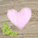Pink heart shape frame in sand beach texture Royalty Free Stock Photography