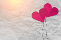 Pink heart shape paper on white crumpled paper. Texture background Royalty Free Stock Photos