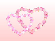 Pink heart shape by petals Royalty Free Stock Images