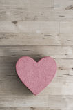 Pink Heart Shaped Box on Wood Plank Table from Above Royalty Free Stock Images