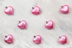 Pink Heart-shaped Christmas ornaments. On the light gray vintage background Stock Photography
