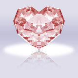 Pink heart-shaped diamond with reflection. Royalty Free Stock Photos