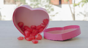 Pink heart-shaped gift box, inside a red heart-shaped candy for. Valentine`s Day Royalty Free Stock Photo