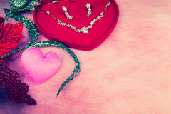 Pink heart-shaped and jewelry in red velvet box Royalty Free Stock Image