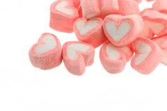 Pink heart shaped marshmallows. On white back ground Stock Image