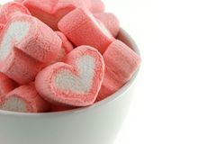 Pink heart shaped marshmallows in the white cup. Isolated on white back ground Royalty Free Stock Photos