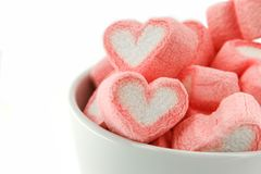 Pink heart shaped marshmallows in the white cup. Isolated on white back ground Stock Photography