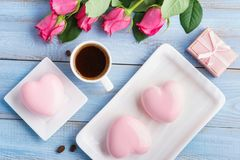 Pink heart shaped mousse cake and hot coffee dessert. stock photography