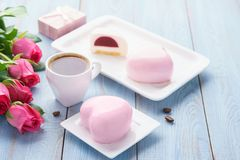 Pink heart shaped mousse cakes with berry filling and hot coffee royalty free stock photos