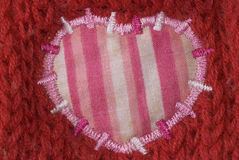 Pink heart shaped patch Stock Image