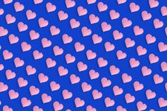 Pink heart shapes on blue background, cute pattern for valentines day or wedding. Romantic decorative backdrop. Pink heart shapes on blue background, cute Vector Illustration