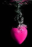 Pink heart splashing on water Stock Photo