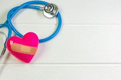 Pink Heart and stethoscopes for medical content. The pink Heart and stethoscopes for medical content stock photo