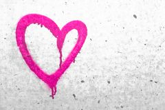 Pink heart symbol. Grungy wall background. Fall in love and Valentine`s day concept Royalty Free Stock Photo