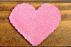 Pink heart on table Stock Image