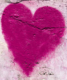Pink heart on the wall. Pink heart made with brush on grungy wall Stock Images