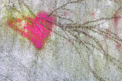 Pink heart on wall. Pink heart on the wall, partially covered by climbing plants Stock Image