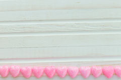 Pink heart on a white. Background wooden Stock Photography
