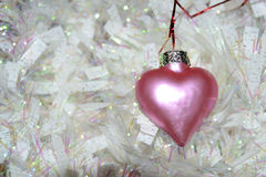 Pink heart and white garland Stock Photo