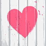 Pink heart on white wall Stock Photography