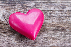 Pink heart on wood Stock Photography