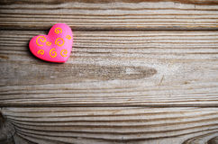 Pink heart on a wooden background. horizontal Stock Images