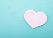 Pink heart on a wooden texture.  stock photo