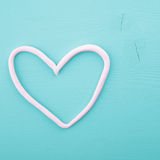 Pink heart on a wooden texture.  Royalty Free Stock Image