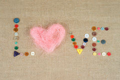 Pink heart and word love writing with sewing buttons Stock Photos