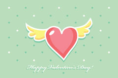 Pink heart with yellow wings on a green background Royalty Free Stock Photo