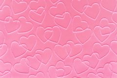 Pink Hearts. Pastel pink linked hearts embossed on paper Royalty Free Stock Photography