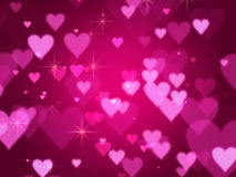 Pink hearts background. Pink hearts and lights over violet background with feather center Stock Images