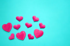 Pink hearts on a background stock photos
