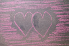Pink hearts on chalkboard background. Royalty Free Stock Photo