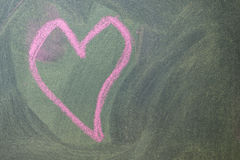 Pink hearts on chalkboard background. Stock Images