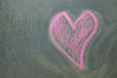 Pink hearts on chalkboard background. Stock Photo