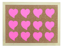 Pink hearts on cork notice board Royalty Free Stock Images