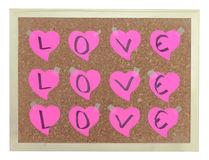 Pink hearts on cork notice board Royalty Free Stock Photography
