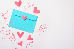 Pink Hearts and Envelope on White Background, Top View stock photos