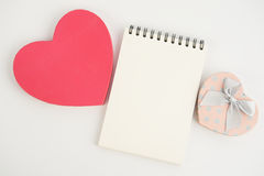 Pink Hearts gift box and note book  on white background Royalty Free Stock Images