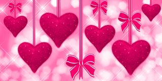 Pink hearts hanging with bows Stock Photos